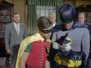 A guy poorly cosplaying as Batman, and a kid wearing a Robin Halloween costume he got a CVS?